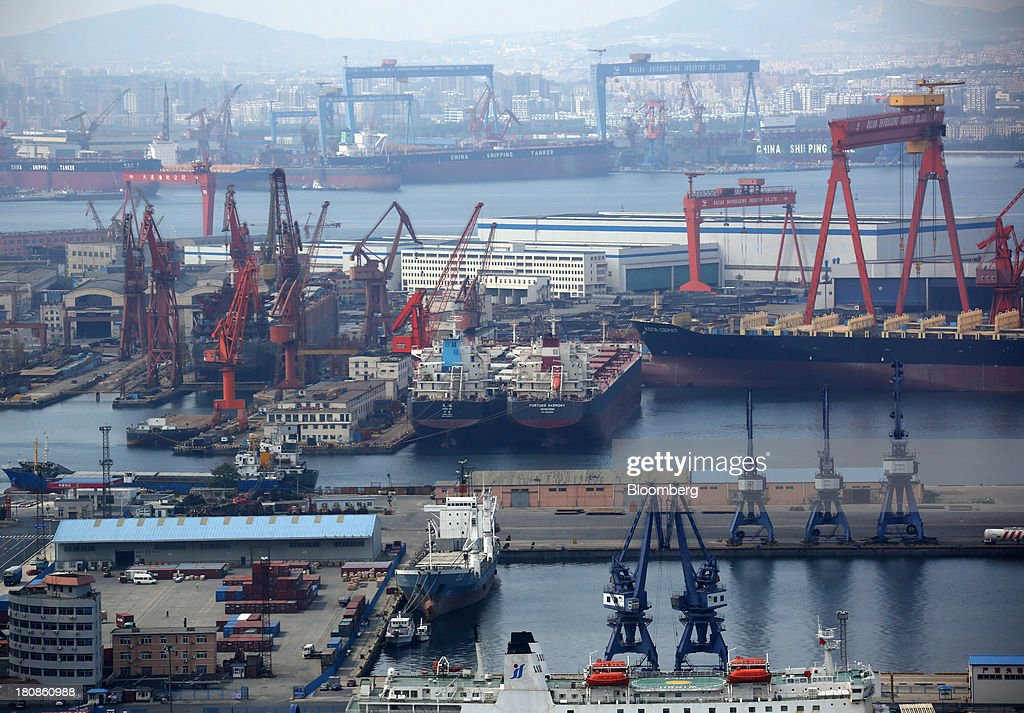 Tankers are moored at the port of Dalian in Dalian, China, on Friday, Sept. 13, 2013. Goldman Sachs Group Inc. this month raised its estimate for China's economic growth for the third and fourth quarters, citing improving global demand and a stronger-than-expected domestic industrial recovery. Photographer: Tomohiro Ohsumi/Bloomberg via Getty Images