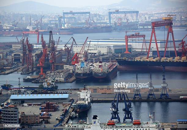 Tankers are moored at the port of Dalian in Dalian China on Friday Sept 13 2013 Goldman Sachs Group Inc this month raised its estimate for China's...