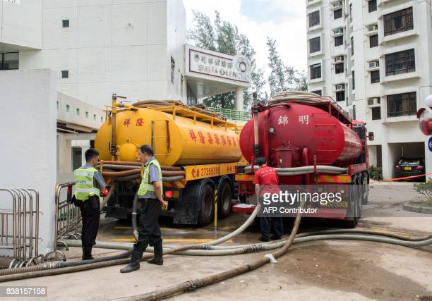 Tankers pump sea water out from a car park in the Heng Fa Chuen area in Hong Kong on August 24 a day after Typhoon Hato created a sea surge which...