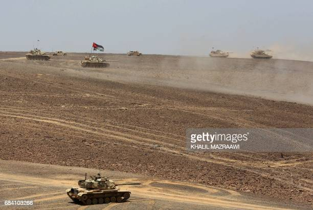 TOPSHOT Tanks advance during the annual military exercises known as 'Eager Lion' near Maan some 200 kilometres south of the capital Amman on May 17...