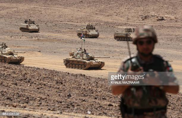 Tanks advance during the annual military exercises known as 'Eager Lion' near Maan some 200 kilometres south of the capital Amman on May 17 2017...