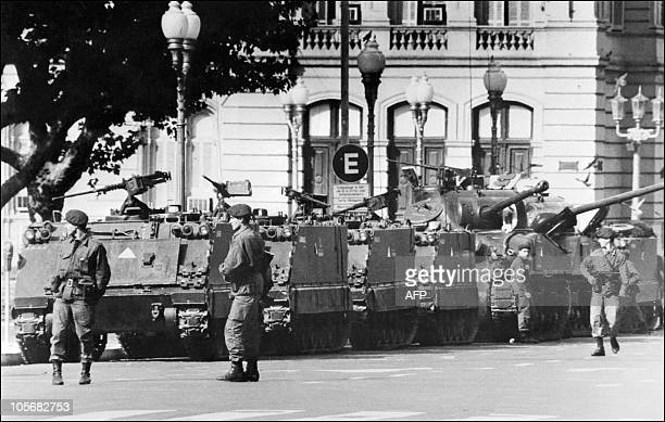 Tanks and soldiers stand in front of the Government Palace the Casa Rosada Buenos Aires 24 March 1976 In the small hours of the morning President...