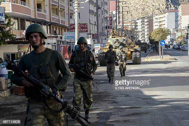 Tanks and Turkish soldiers patrol a street in the Silvan district after clashes between Turkish forces and Kurdish militans in Silvan on November 14...