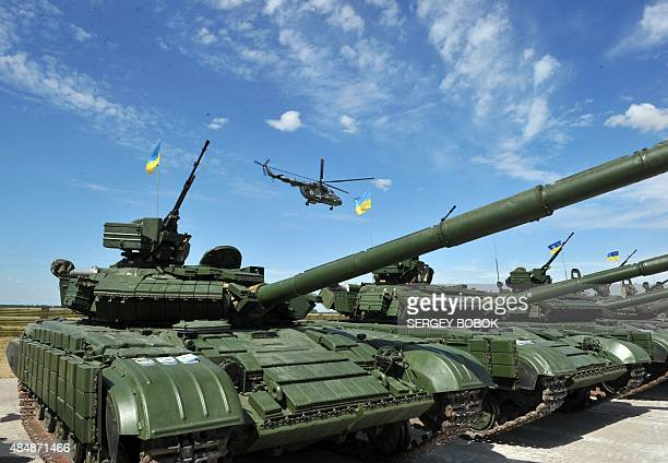 Tanks are pictured ahead of a ceremony marking the handing over of heavy military equipments to Ukrainian forces in northeastern town of Chuguev...