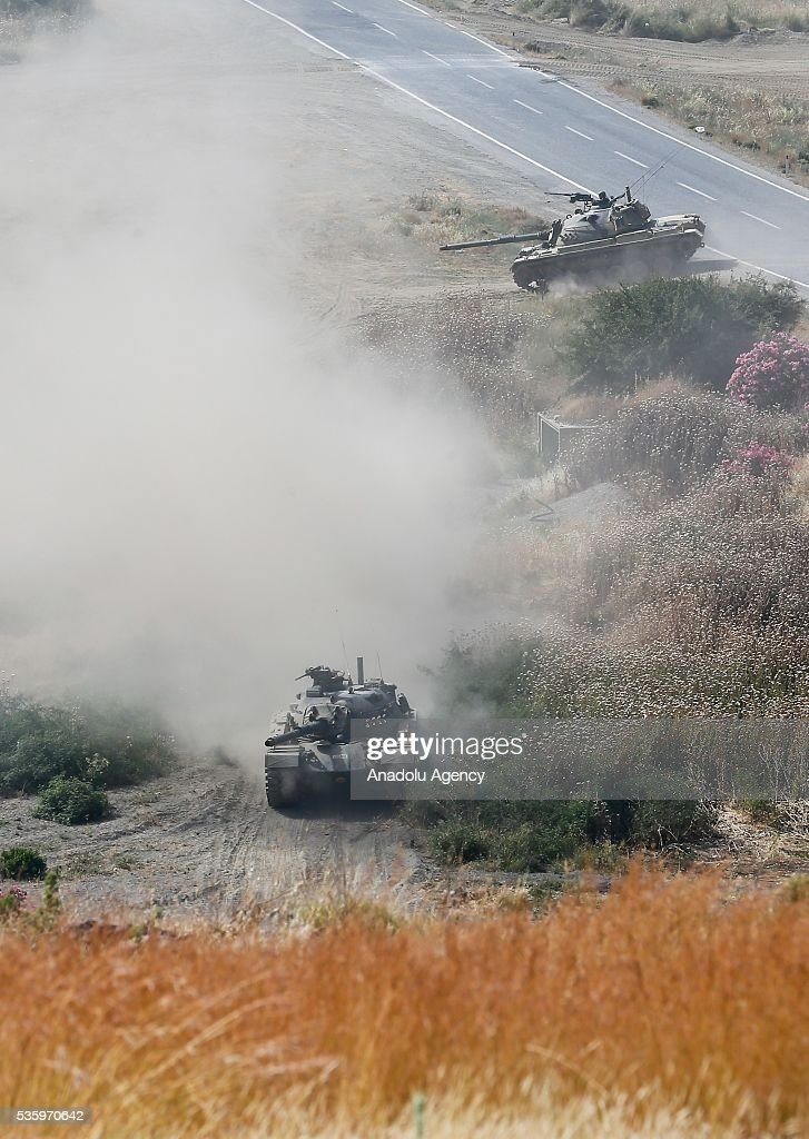 Tanks are seen during the Efes-2016 Combined Joint Live Fire Exercise at Seferihisar district of Izmir, Turkey on May 30, 2016. The Turkish-led multinational military exercises, Efes-2016 which started at 04 May and will be finished at 04 June 2016, aims to train participating units and staff in planning and conducting combined and joint operations, including logistics and command-control as well as to improve the level of interoperability among headquarters and forces.