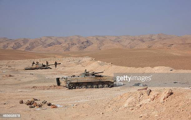 Tanks belonging to Syrian government forces are positioned near the Jazel oil field near the ancient city of Palmyra in the east of Homs province...