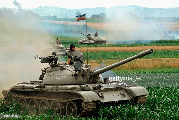Tanks belonging to the Serbian army crush corn plants in their path as they advance after being called in by the central government to quash the...