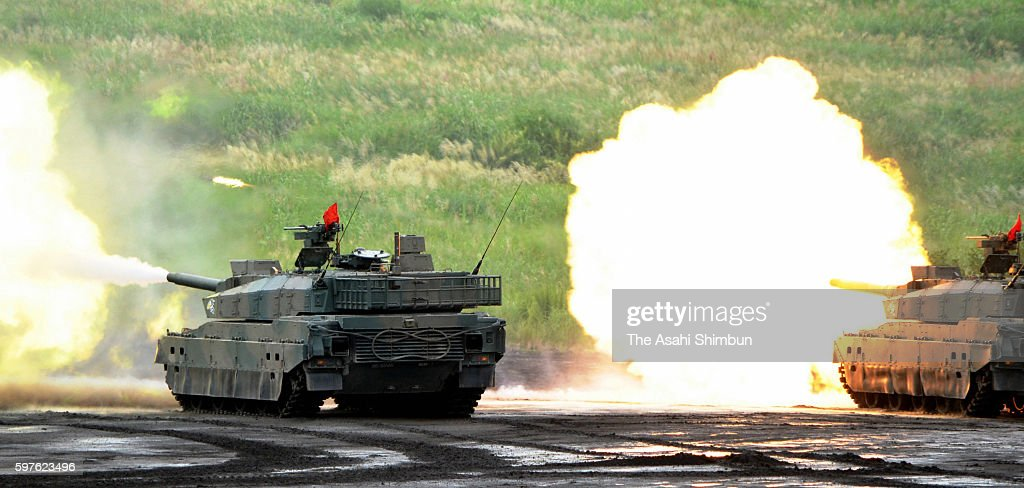 Tanks fire during the annual live firing exercise at the JGSDF HigashiFuji training range on August 28 2016 in Gotemba Shizuoka Japan