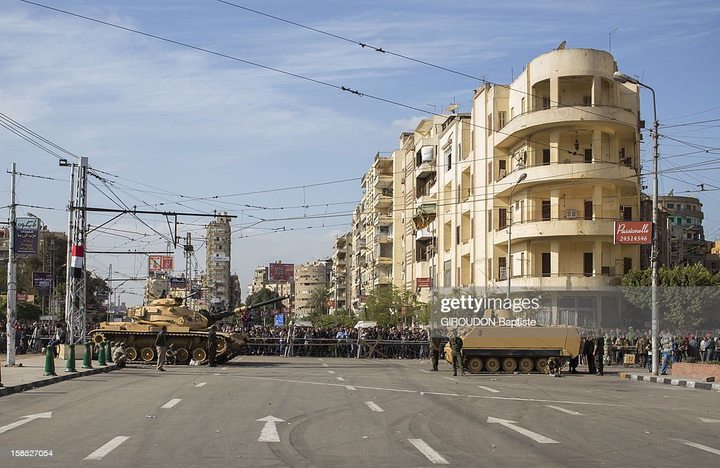 Tanks from the army block the street leading to the Presidential Palace on December 6, 2012 in Cairo,Eqypt.