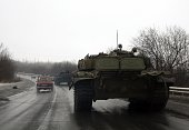 Tanks of proRussian separatists ride towards the eastern Ukrainian city of Donetsk on January 22 2015 At least 41 people were killed in Ukraine's...