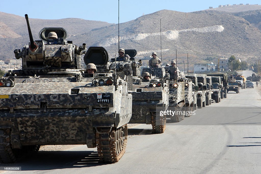 Tanks of the Lebanese airborne division drive in the east Lebanon village of Arsal, near the Syrian border on February 4, 2013. Lebanon's army chief Jean Kahwaji has warned that the military will 'pursue' anyone who attacks it, after two troops were killed in a clash with Islamists in Arsal on February 1.