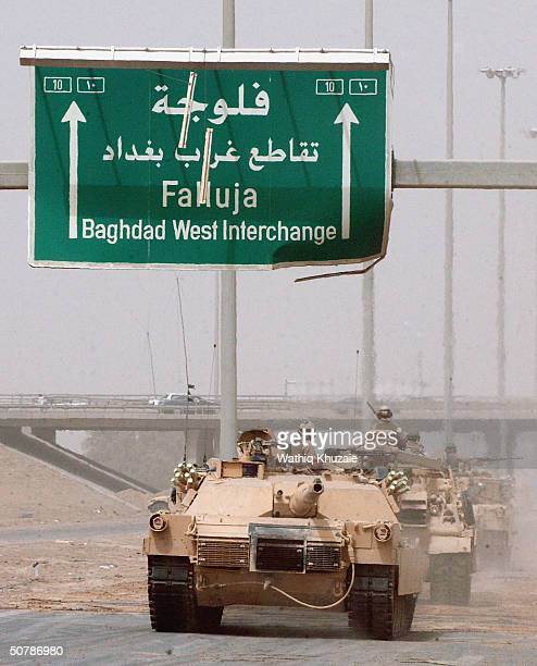S tanks roll away from their positions on the outskirts of the flashpoint Iraqi city of Fallujah April 30 2004 in Iraq US forces began a limited...