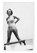 Tanned Girl with Swimwear in 1935.Black And White