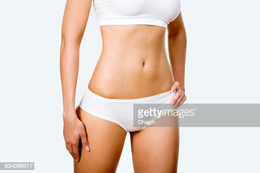 Tanned woman's body : Stock Photo