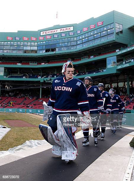 Tanner Creel of the Connecticut Huskies walks towards the ice surface during an NCAA hockey game against the Maine Black Bears at Fenway Park during...