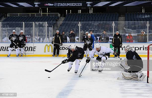 Tanner Glass and Sidney Crosby of the Pittsburgh Penguins skate during the 2014 NHL Stadium Series practice day at Soldier Field on February 28 2014...