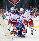 Tanner Glass and Viktor Stalberg of the New York Rangers go against Marek Zidlicky of the New York Islanders during the first period at the Barclays...