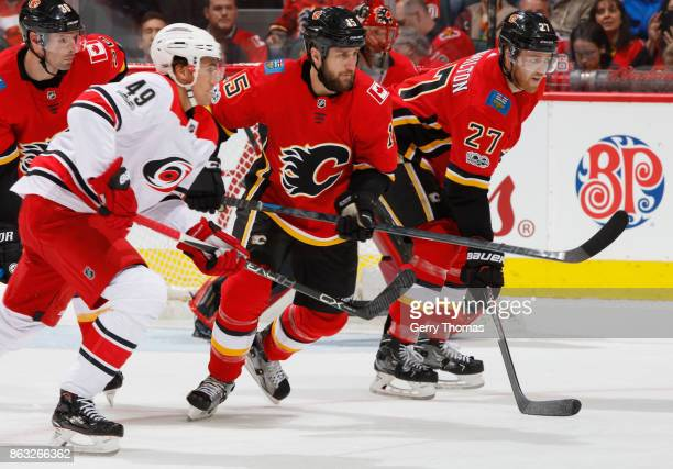 Tanner Glass of the Calgary Flames faces against Victor Rask of the Carolina Hurricanes at Scotiabank Saddledome on October 19 2017 in Calgary...