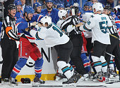 Tanner Glass of the New York Rangers and Andrew Desjardins of the San Jose Sharks fight in the third period at Madison Square Garden on October 19...