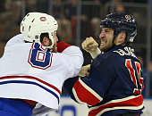 Tanner Glass of the New York Rangers and Brandon Prust of the Montreal Canadiens go toetotoe during the first period at Madison Square Garden on...