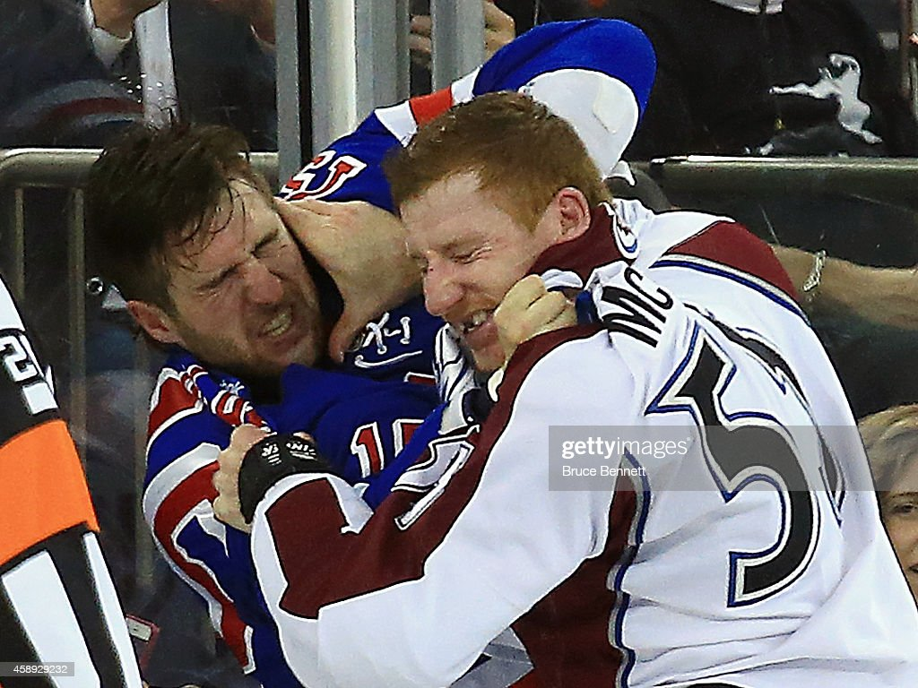 Tanner Glass of the New York Rangers and Cody McLeod of the Colorado Avalanche fight during the first period at Madison Square Garden on November 13...