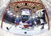 Tanner Glass of the New York Rangers clears the puck away from the net against the Pittsburgh Penguins at Madison Square Garden on November 11 2014...