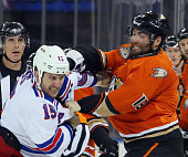 Tanner Glass of the New York Rangers fights with Patrick Maroon of the Anaheim Ducks during the first period at Madison Square Garden on December 22...