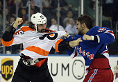 Tanner Glass of the New York Rangers fights with Zack Stortini of the Philadelphia Flyers during the first period at Madison Square Garden on...