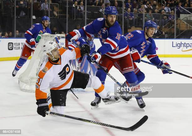 Tanner Glass of the New York Rangers hits Valtteri Filppula of the Philadelphia Flyers at Madison Square Garden on April 2 2017 in New York City The...