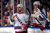 Tanner Glass of the New York Rangers looks on from the bench against the New York Islanders during a game at the Nassau Veterans Memorial Coliseum on...
