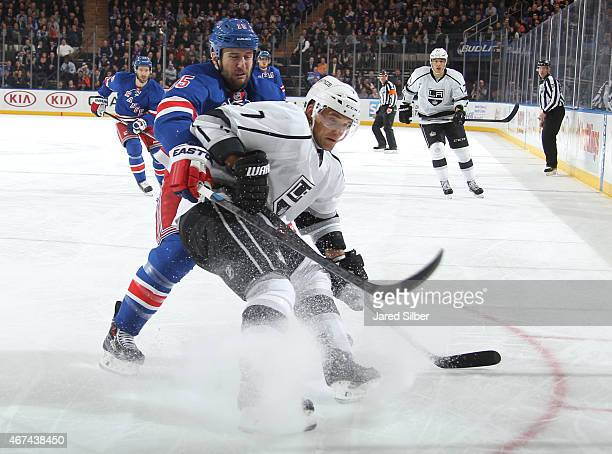 Tanner Glass of the New York Rangers skates against Andrej Sekera of the Los Angeles Kings at Madison Square Garden on March 24 2015 in New York City