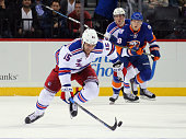 Tanner Glass of the New York Rangers skates against the New York Islanders during the first period at the Barclays Center on December 2 2015 in the...