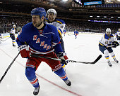 Tanner Glass of the New York Rangers skates against the St Louis Blues at Madison Square Garden on November 3 2014 in New York City The Blues...