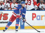 Tanner Glass of the New York Rangers skates with the puck against the Florida Panthers at Madison Square Garden on February 2 2015 in New York City...