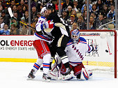 Tanner Glass of the Pittsburgh Penguins and Steve Eminger of the New York Rangers screen Henrik Lundqvist during the game at Consol Energy Center on...
