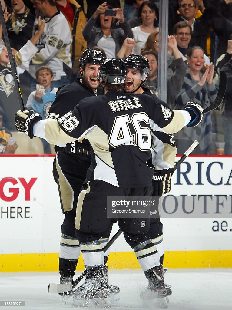 <a gi-track='captionPersonalityLinkClicked' href=/galleries/search?phrase=Tanner+Glass&family=editorial&specificpeople=4596666 ng-click='$event.stopPropagation()'>Tanner Glass</a> #15 of the Pittsburgh Penguins celebrates his goal with <a gi-track='captionPersonalityLinkClicked' href=/galleries/search?phrase=Matt+Niskanen&family=editorial&specificpeople=2106633 ng-click='$event.stopPropagation()'>Matt Niskanen</a> #2 and Joe Vitale #46 during the third period against the Carolina Hurricanes on October 8, 2013 at Consol Energy Center in Pittsburgh, Pennsylvania. Pittsburgh won the game 5-2.