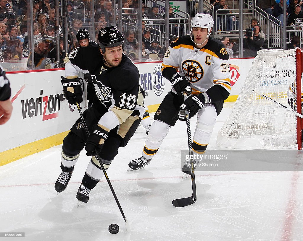 <a gi-track='captionPersonalityLinkClicked' href=/galleries/search?phrase=Tanner+Glass&family=editorial&specificpeople=4596666 ng-click='$event.stopPropagation()'>Tanner Glass</a> #10 of the Pittsburgh Penguins moves the puck in front of <a gi-track='captionPersonalityLinkClicked' href=/galleries/search?phrase=Zdeno+Chara&family=editorial&specificpeople=203177 ng-click='$event.stopPropagation()'>Zdeno Chara</a> #33 of the Boston Bruins on March 12, 2013 at Consol Energy Center in Pittsburgh, Pennsylvania.