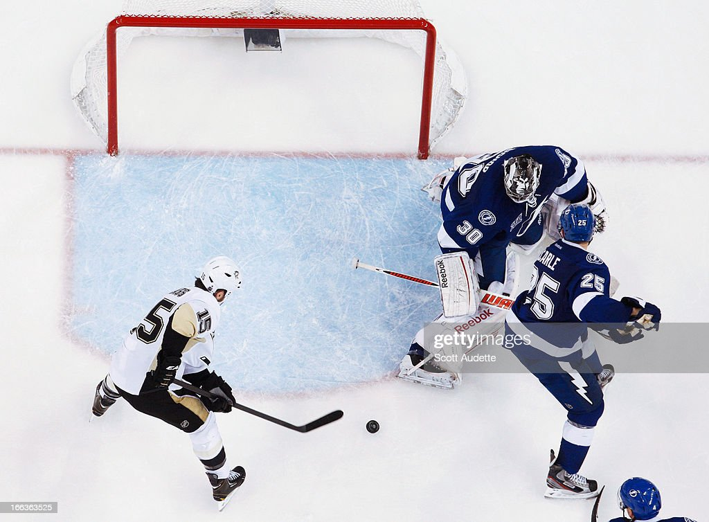 <a gi-track='captionPersonalityLinkClicked' href=/galleries/search?phrase=Tanner+Glass&family=editorial&specificpeople=4596666 ng-click='$event.stopPropagation()'>Tanner Glass</a> #15 of the Pittsburgh Penguins scores in the third period of the game against the Tampa Bay Lightning at the Tampa Bay Times Forum on April 11, 2013 in Tampa, Florida.