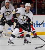 Tanner Glass of the Pittsburgh Penguins skates during an NHL hockey game against the New Jersey Devils at Prudential Center on December 31 2013 in...