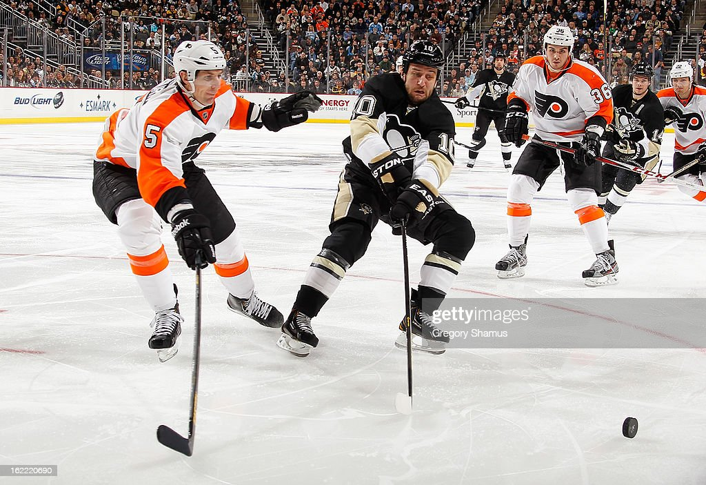 <a gi-track='captionPersonalityLinkClicked' href=/galleries/search?phrase=Tanner+Glass&family=editorial&specificpeople=4596666 ng-click='$event.stopPropagation()'>Tanner Glass</a> #10 of the Pittsburgh Penguins skates for the loose puck alongside <a gi-track='captionPersonalityLinkClicked' href=/galleries/search?phrase=Braydon+Coburn&family=editorial&specificpeople=2077063 ng-click='$event.stopPropagation()'>Braydon Coburn</a> #5 of the Philadelphia Flyers on February 20, 2013 at Consol Energy Center in Pittsburgh, Pennsylvania. Philadelphia won the game 6-5.