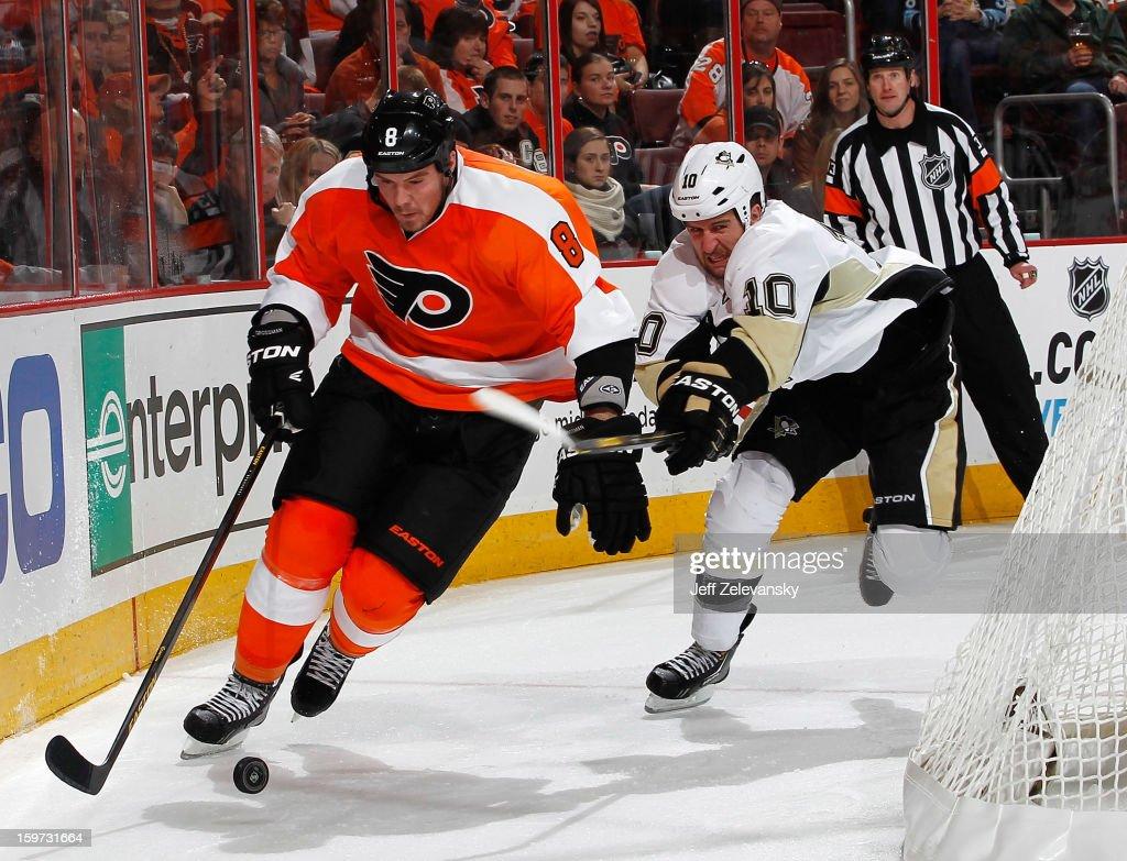 Tanner Glass #10 of the Pittsburgh Penguins skates with Nicklas Grossmann #8 of the Philadelphia Flyers at Wells Fargo Center on January 19, 2013 in Philadelphia, Pennsylvania.
