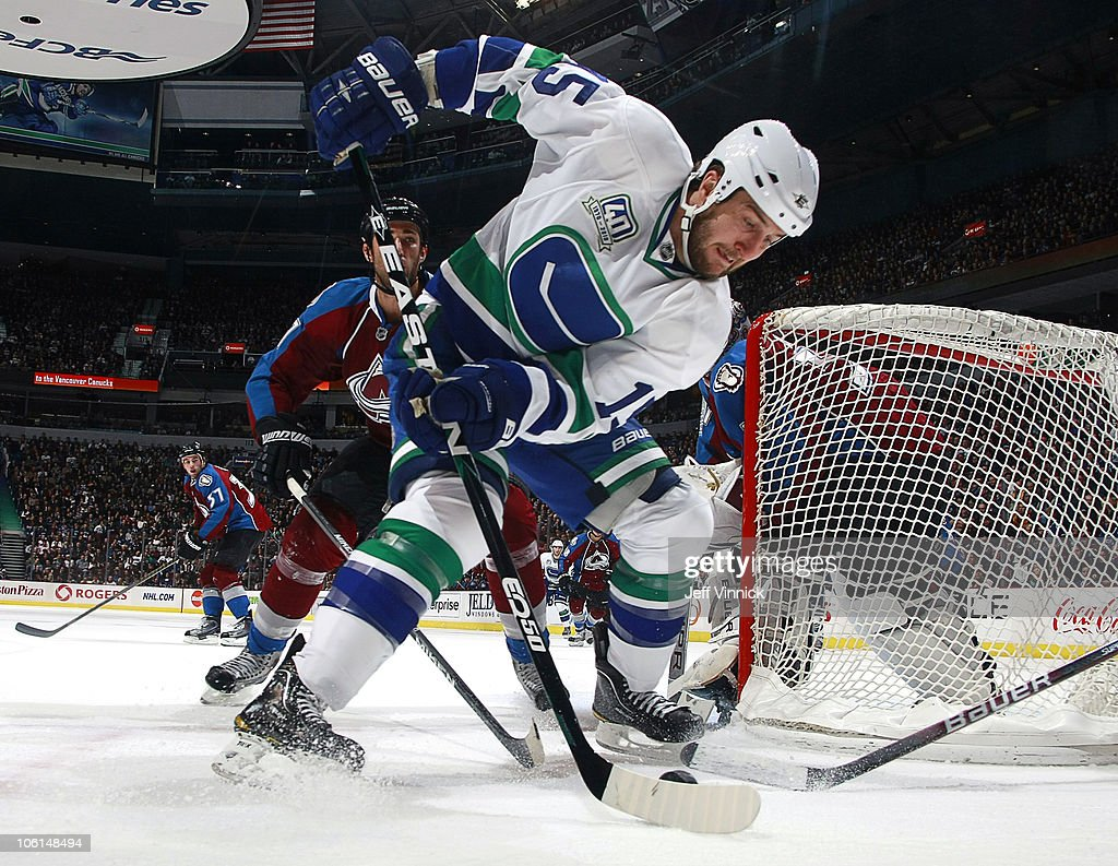 Tanner Glass #15 of the Vancouver Canucks turns with the puck at Rogers Arena on October 26, 2010 in Vancouver, British Columbia, Canada