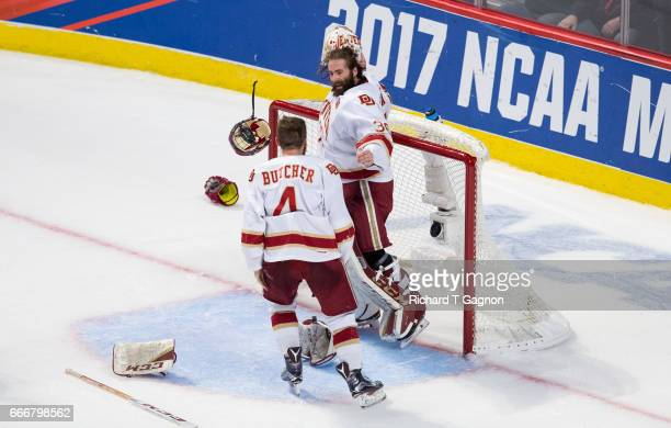 Tanner Jaillet and Will Butcher both of the Denver Pioneers celebrate a victory against the Minnesota Duluth Bulldogs during the 2017 NCAA Division I...
