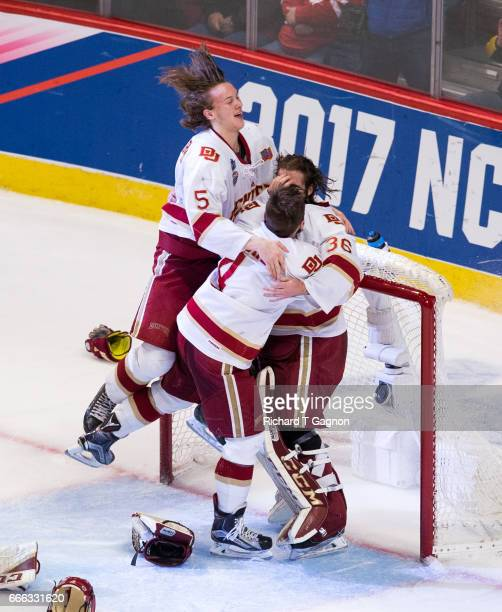 Tanner Jaillet Henrik Borgstrom and Will Butcher all of the Denver Pioneers celebrate a victory against the Minnesota Duluth Bulldogs during the 2017...