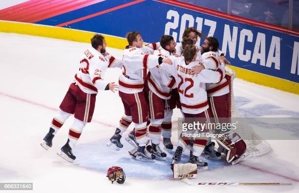 Tanner Jaillet Henrik Borgstrom Logan OâConnor and Will Butcher all of the Denver Pioneers celebrate a victory against the Minnesota Duluth Bulldogs...