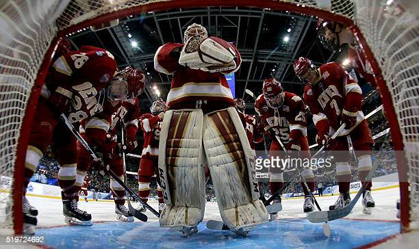 Tanner Jaillet of the Denver Pioneers and the rest of his teamamtes huddle before the game against the North Dakota Fighting Hawks during semifinals...
