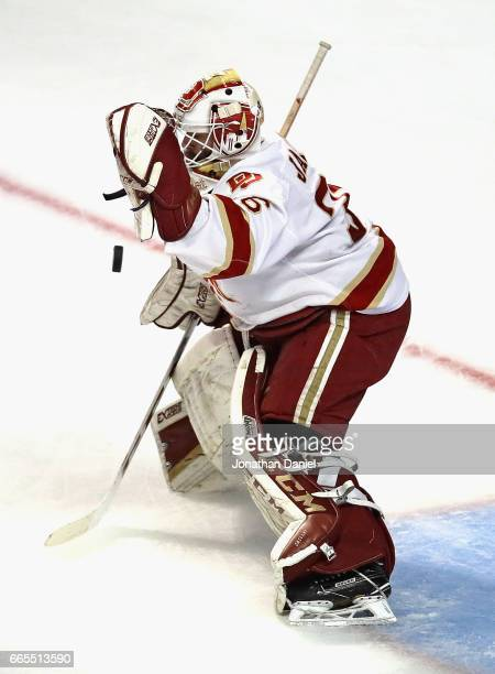 Tanner Jaillet of the Denver Pioneers knocks down the puck against the Notre Dame Fighting Irish during game two of the 2017 NCAA Division I Men's...