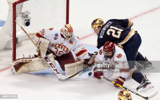 Tanner Jaillet of the Denver Pioneers makes a save against the Notre Dame Fighting Irish during game two of the 2017 NCAA Division I Men's Hockey...