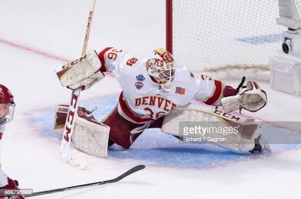 Tanner Jaillet of the Denver Pioneers makes a save against the Minnesota Duluth Bulldogs during the 2017 NCAA Division I Men's Hockey Frozen Four...