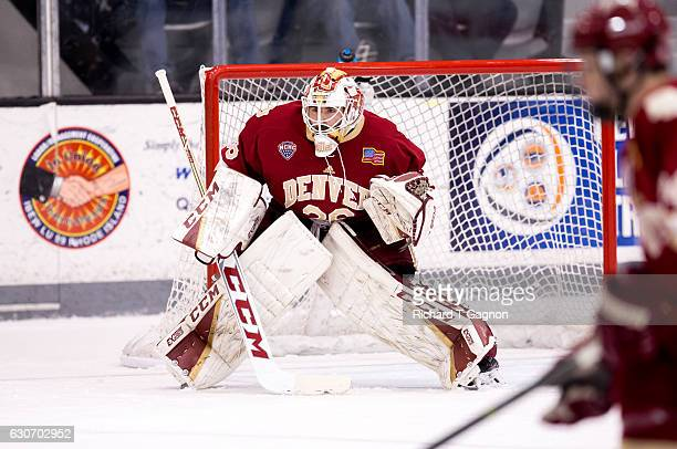 Tanner Jaillet of the Denver Pioneers tends goal against the Providence College Friars during NCAA hockey at the Schneider Arena on December 30 2016...